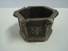 Antique ashtray in bronze in mortar form with some coats