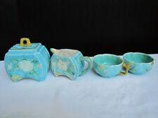Antique five piece English porcelain tea set with Asian floral designs.