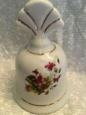 porcelain bell violets. Fan handle. Gold trim.
