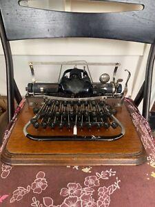 Antique Blickensderfer typewriter. #7 USA, with wooden vase!