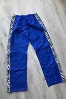 90s VINTAGE ASICS TAPE LOGO TRACKSUIT BOTTOMS BLUE TRACK PANTS NYLON MENS L