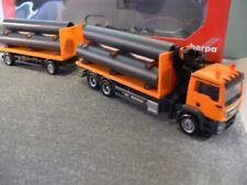 1/87 Herpa MAN TGS M Flachbett-HZ orange mit Ladekran+Ladegut Röhren 305631