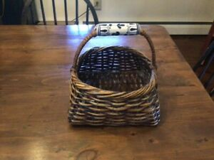 Beautiful country wicker/rattan basket with porcelain blue and white handle