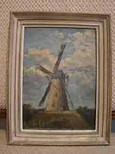 Huile sur toile d'un moulin à vent dans un ciel couronné de nuages
