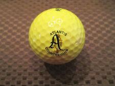 LOGO GOLF BALL-ATLANTIS COUNTRY CLUB......YELLOW BALL.....FLORIDA
