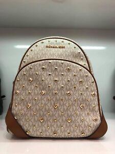 Michael Kors Abbey Medium Pyramid Stud Backpack  in PVC/Leather Vanilla/Acorn.