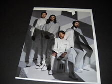 Imagine Dragons all four dressed nattily in white Promo Poster Ad