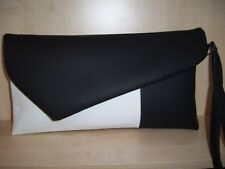 VERY LARGE BLACK & WHITE faux leather asymmetrical clutch bag, with wrist strap.