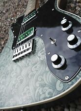 T' deluxe style electric guitar with green surf fabric finish. P90s.