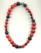 Peru High Andes: Necklace made of wayruros and black native seeds