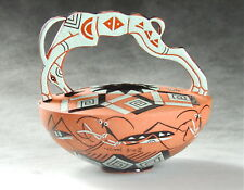 Mariko Swisher contemporary ceramist, sculpted vase with leaping antelope