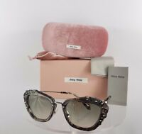Brand New Authentic MIU MIU SMU 04Q DHE-3H2 Sunglasses Grey marble Crystal Frame