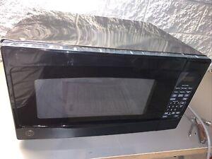 GE 2-cu ft 1200-Watt Countertop Microwave Oven - Black - JES2051DN2BB