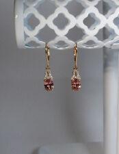 10k Rose Gold 3.83ctw Oval Pink Zircon & Round White Zircon Leverback Earrings