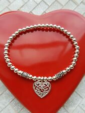 silver plated stretchy stacking bracelet with filigree heart charm