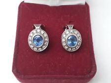 7927c5b76 18ct white gold 2ct aquamarine 0.52ct diamond cluster earrings.