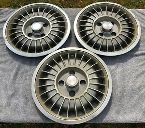 "THREE 1978 1979 1980 CHEVROLET CHEVETTE 13"" HUBCAPS"
