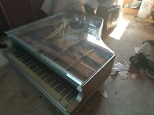 Glass piano coffee table