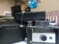 POLAROID LAND CAMERA 101 W/BAG AND ACCESSORIES