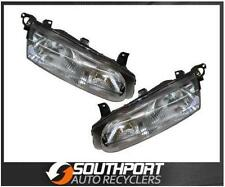 FORD FALCON HEADLIGHTS TO SUIT EL 1996-1998 MODELS *NEW PAIR*