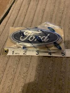 FORD BADGE. ADHESIVE. NEW. GENUINE.