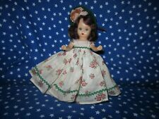Storybook doll in floral dress
