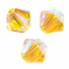 15 Perles Toupies 4mm Cristal Swarovski - LIGHT TOPAZ AB2X