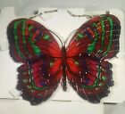 joan baker stained glass,  magenta/green BUTTERFLY sun catcher 9x8 with holes