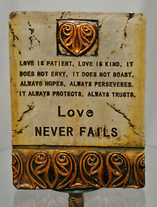 LOVE NEVER FAILS Ceramic Wall Art - Brand New