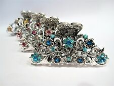 Silver metal hair claw clip with flowers, leaves and crystals