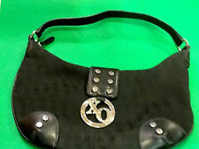 XOXO BLACK PURSE WITH XO SILVER MEDALLION