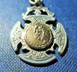Antique silver with  gold  shield watch  fob/ pendant.  Birmingham 1899   (Help)