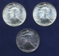 1987 & 1991, AMERICAN SILVER EAGLES, CHOICE AND GEM UNCIRCULATED COINS, LOT OF 3