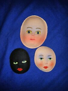3  vintage moulded fabric black and white doll faces
