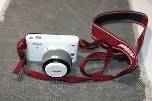 Nikon 1 J1 Mirrorless Digital Camera with 10-30mm Lens in White
