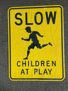 """SLOW CHILDREN sign 18 X 24"""" aluminum with nice crazing and cracking"""