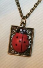 Delightful Open Swirled Rim Rectangle Lady Bug Brasstone Pendant Necklace +