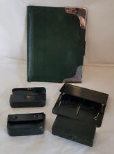 An Edwardian Dark green leather bound travelling set. London 1903 .By Finnigans