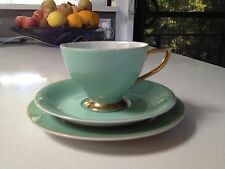 Tea cup, saucer and plate in pastel green with gilded edges, Japan