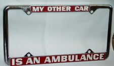 1970s VINTAGE MY OTHER CAR IS AN AMBULANCE NOS METAL LICENSE PLATE FRAME -NICE!
