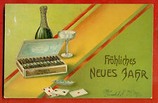 CIGAR BOXE, BOTTLE CHAMPAGNE AND PLAYING CARDS VINTAGE EMBOSSED POSTCARD 231