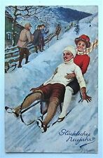 A/S Tuck Oilette #821 COUPLE Toboggan Sled on Snowy Track NEW YEAR Postcard
