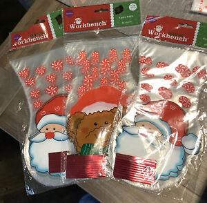 NOS 4Pks Of 20 Santa's Workbench Cello Bags-2 With Santa Faces & 2 W Teddy Bear