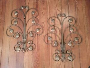 Very nice set of iron wall mount candle holders..bronze finish with leaves throu