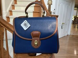 BRAND NEW WITH TAGS VINTAGE COACH MONTICELLO BAG IN MARINE BLUE AND BROWN. RARE!