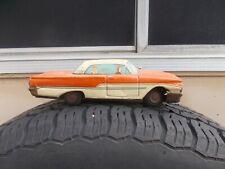 vintage tin car (fairlane?)