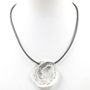 Matt Silver Swirl necklace on grey leather