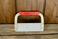 VINTAGE RIPPLED WAVY CHEESE/BUTTER CUTTER WITH red handle