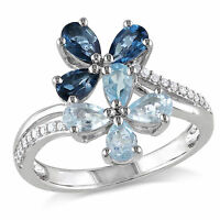 Amour Sterling Silver Blue Topaz and 1/10 Ct TDW Diamond Flower Ring H-I I2-I3
