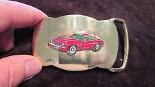 BELT BUCKLE ( SOLID BRASS WITH RED CAMARO )